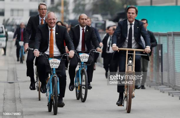 Netherlands' Prime Minister Mark Rutte rides a wooden bicycle during the Bogota Bike Fair 'Bicigo' to officially open the Netherlands stand in Bogota...