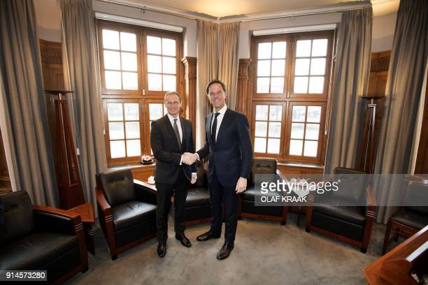 Netherlands Prime Minister Mark Rutte shakes hands with Berlin Mayor Michael Muller President of the Bundesrat of Germany ahead of a meeting in The...