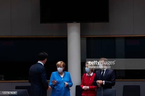 TOPSHOT Netherlands' Prime Minister Mark Rutte talks with Germany's Chancellor Angela Merkel President of the European Commission Ursula von der...