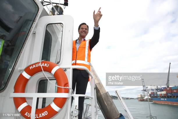 Netherlands Prime Minister Mark Rutte waves from the Ports of Auckland tugboat Hauraki on October 08, 2019 in Auckland, New Zealand. Netherlands...