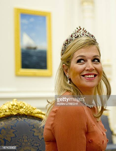 Netherland's Princess Maxima gets a present from Sultan Qaboos of Oman during a state banquet in the Al Alam Palace in Muscat on January 10 2012 The...