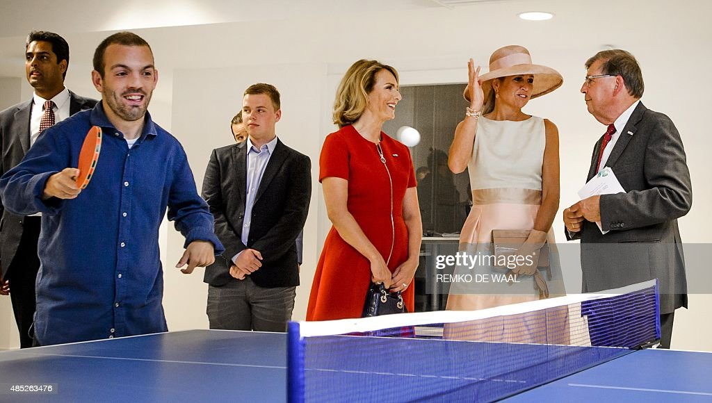 Netherland's Queen Maxima (2nd R) and chairman Aaltje van Zweden - van Buuren (C) are pictured during the opening of the Papageno House in Laren, The Netherlands, on August 26, 2015. Young people with autism at the learn to live independently and to take part in work experience programs in this house.