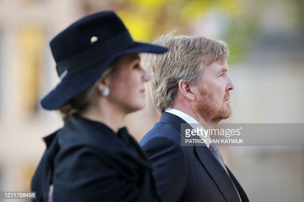 Netherlands' Queen Maxima and King Willem-Alexander pay their respects during a wreath-laying ceremony on May 4, 2020 in Amsterdam on Dam Square to...