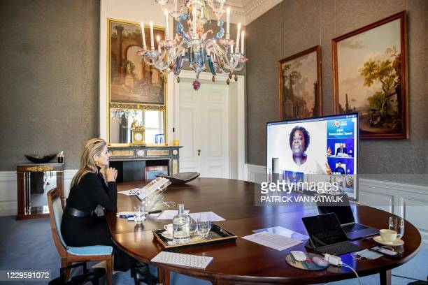 Netherland's Queen Maxima looks on as World Bank Vice President East Asia and Pacific Victoria Kwakwa speaks on screen to The ASEAN Women Leaders'...