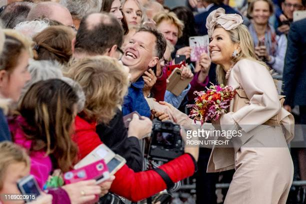 Netherlands' Queen Maxima poses for selfie pictures as she visits Jong Hoogeveen, on September 18, 2019 in Hoogeveen, during a regional visit to...