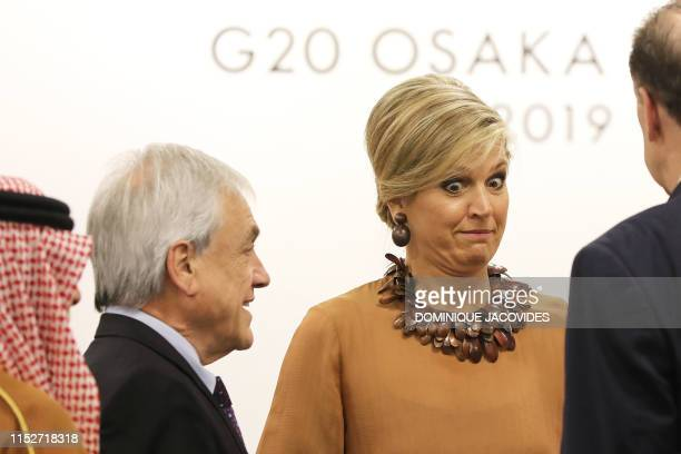 """Netherlands' Queen Maxima reacts during an event on the theme """"Promoting the place of women at work"""" on the sidelines of the G20 Summit in Osaka on..."""