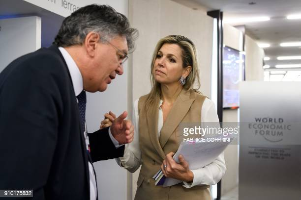 Netherlands' Queen Maxima speaks with a delegate inside the Congress Centre during the World Economic Forum annual meeting on January 25 2018 in...