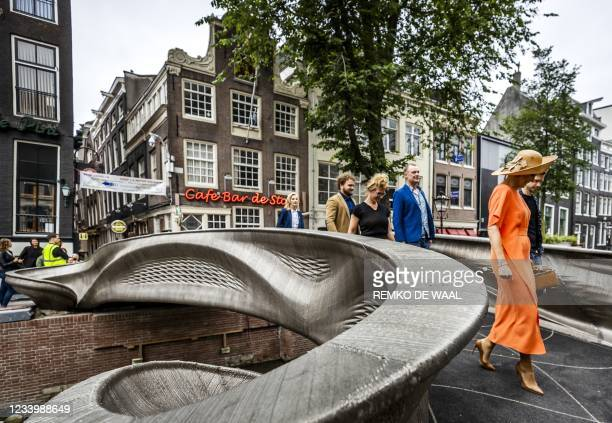 Netherlands' Queen Maxima walks across a 3D-printed bridge during its opening on the Oudezijds Achterburgwal in Amsterdam on July 15, 2021. -...