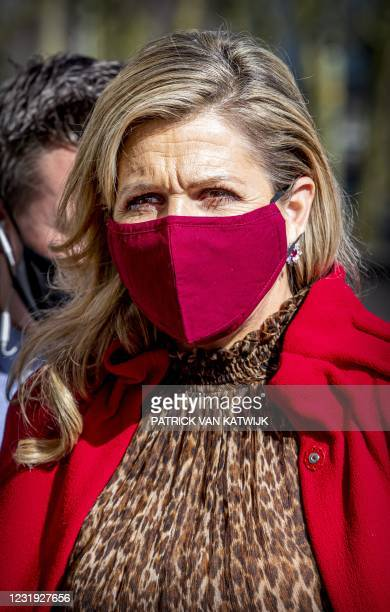 Netherland's Queen Maxima wearing a protective face mask visits an event of non-profit credit organization Qredits in The Hague on March 25 2021. -...