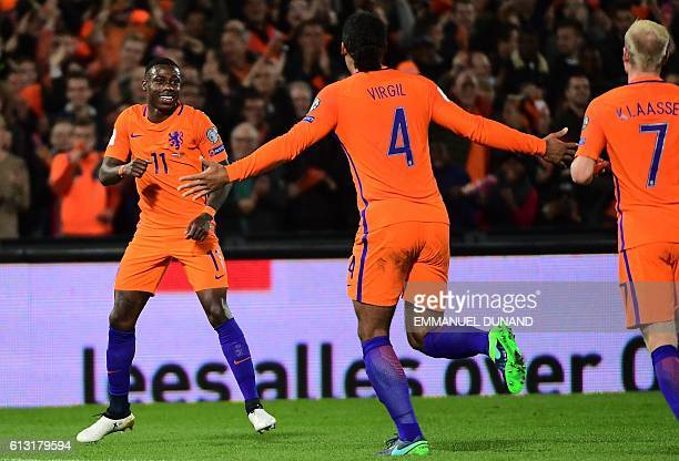 Netherlands' Quincy Promes celebrates after scoring his second goal during the FIFA World Cup 2018 qualification football match between The...