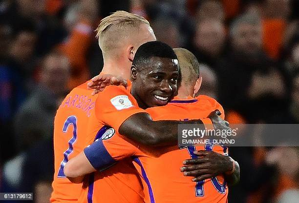 Netherlands' Quincy Promes celebrates with teammates after scoring his second goal during the Fifa World Cup 2018 football qualification match...