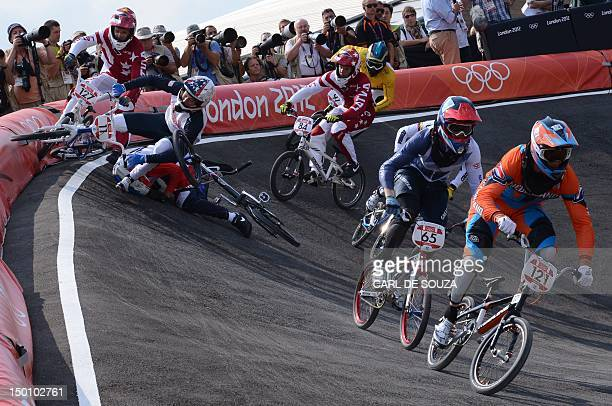 Netherlands' Raymon van der Biezen and Britain's Liam Phillips ride on as France's Quentin Caleyron, US BMX cyclist Connor Fields, Latvia's Edzus...