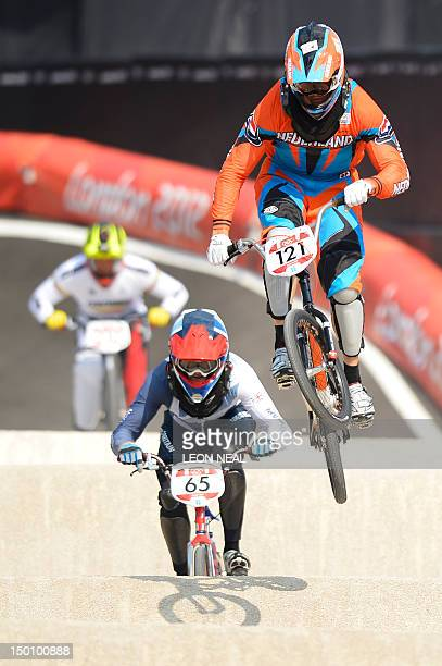 Netherlands' Raymon van der Biezen rides ahead of Britain's Liam Phillips during the men's BMX cycling semi-finals at the London 2012 Olympic Games...