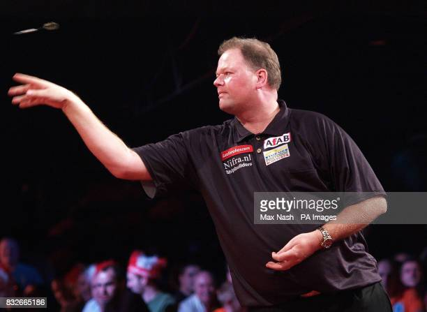 Netherland's Raymond van Barneveld in action against England's Andy Jenkins during the semifinal of the PDC Ladbrokescom World Championships at...