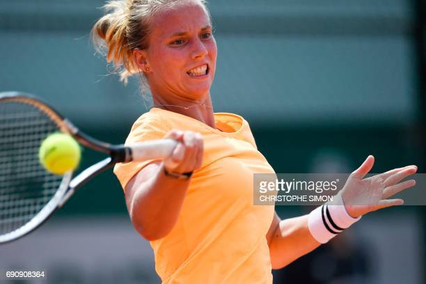 Netherlands' Richel Hogenkamp returns the ball to Belgium's Elise Mertens during their tennis match at the Roland Garros 2017 French Open on May 31...