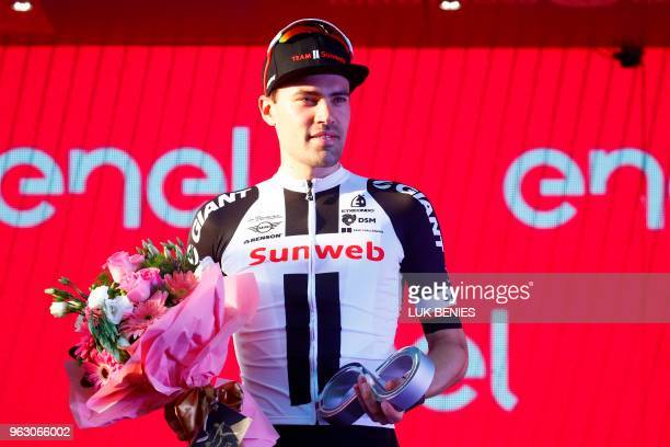 Netherlands' rider of team Sunweb Tom Dumoulin 2nd placed in the general classification celebrates on the podium after the 21st and last stage of the...