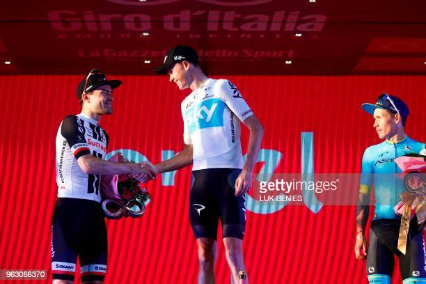 Netherlands' rider of team Sunweb Tom Dumoulin 2nd placed in the general classification congratulates pink jersey and winner Britain's rider of team...