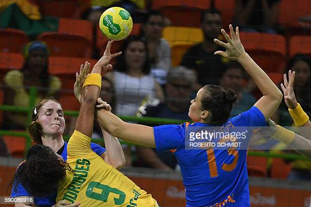 Netherlands' right back Laura van der Heijden and Netherlands' pivot Yvette Broch vie with a Brazilian player during the women's quarterfinal...