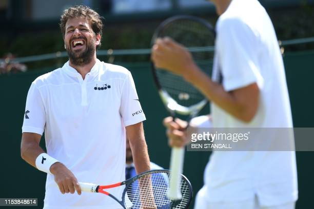 Netherlands' Robin Haase laughs with Denmark's Frederik Nielsen as they play Britain's Ken Skupski and Australian's John Patrick Smith during their...