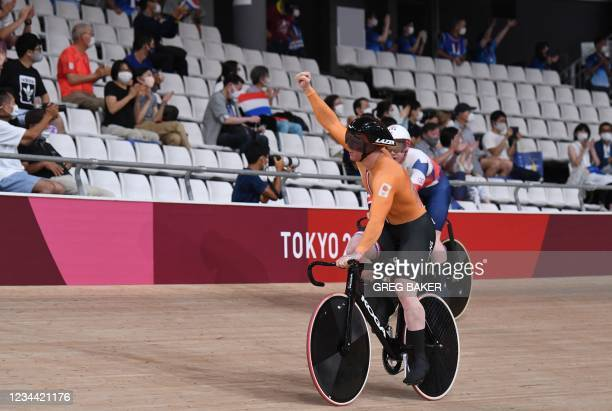 Netherland's Roy van den Berg celebrates winning the gold medal in the men's track cycling team sprint finals during the Tokyo 2020 Olympic Games at...