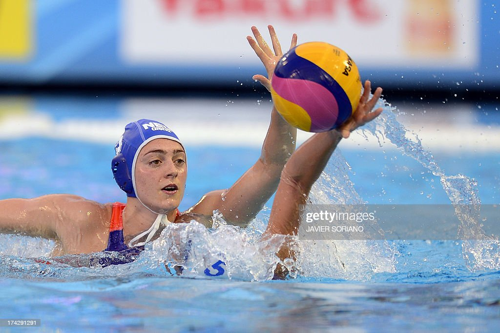 Netherlands' Sabrina van der Sloot (L) vies with Uzbekistan's Evgeniya Ivanova (R) during the preliminary round match between Uzbekistan and Netherlands in the women's water polo competition at the FINA World Championships in Bernat Picornell pools in Barcelona on July 23, 2013.