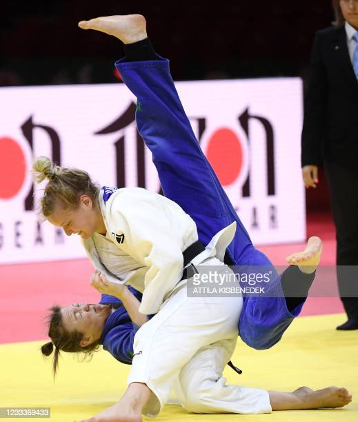 Netherlands' Sanne van Dijke fights against Ireland's Megan Fletcher in the quarter final of the women's -70kg category during the fifth day of the...