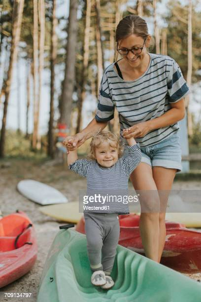 Netherlands, Schiermonnikoog, mother walking with little daughter on a boat