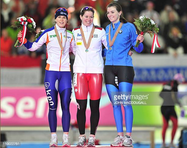 Netherland's second placed Ireen Wuest Canada's winner Christine Nesbitt and third placed Heather Richardson of the US celebrate with their medals on...