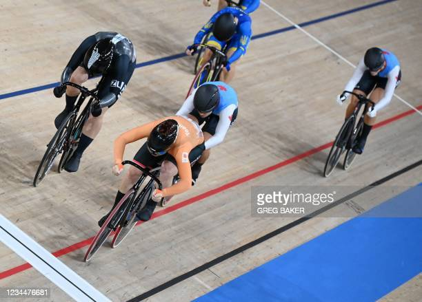 Netherlands' Shanne Braspennincx competes to win gold in the women's track cycling keirin final during the Tokyo 2020 Olympic Games at Izu Velodrome...
