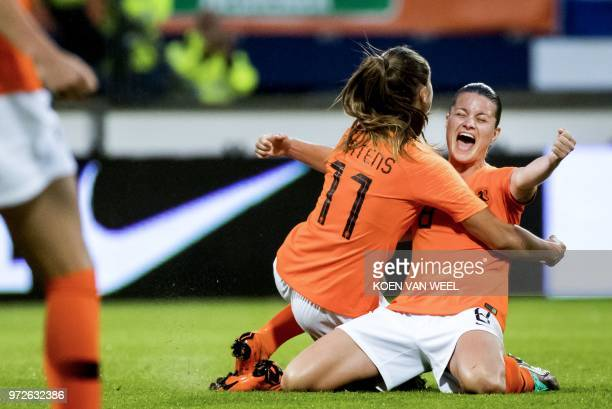 Netherlands' Sherida Spitse celebrates the goal of Lieke Martens during the Women's 2019 World Cup Qualification football match between the...