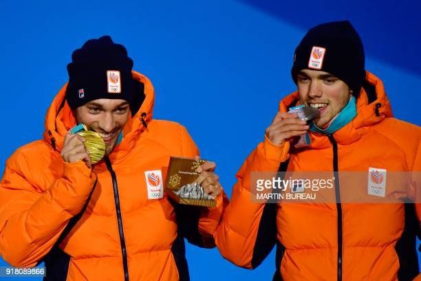 Netherlands' silver medallist Patrick Roest and Netherlands' gold medallist Kjeld Nuis bite their medals as they pose on the podium during the medal...