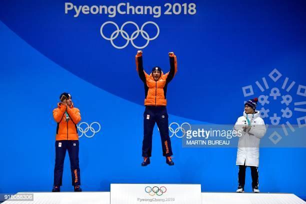 TOPSHOT Netherlands' silver medallist Patrick Roest Netherlands' gold medallist Kjeld Nuis and South Korea's bronze medallist Kim Min Seok pose on...