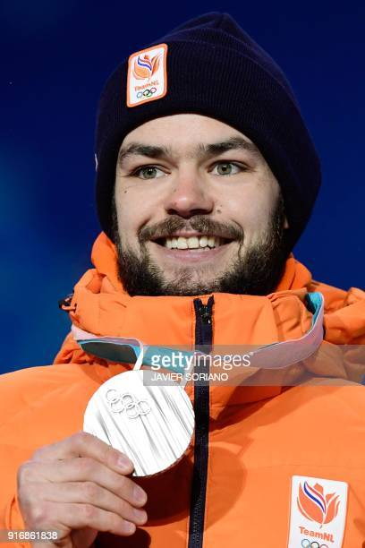 Netherlands' silver medallist Sjinkie Knegt poses on the podium during the medal ceremony for the Men's short track 1500m at the Pyeongchang Medals...