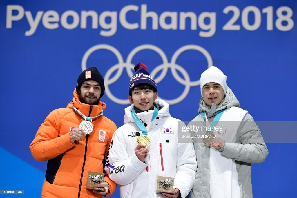 Netherlands' silver medallist Sjinkie Knegt, South Korea's gold medallist Lim Hyo-jun and Russia's bronze medallist Semen Elistratov pose on the podium during the medal ceremony for the Men's short track 1500m at the Pyeongchang Medals Plaza during the Pyeongchang 2018 Winter Olympic Games in Pyeongchang on February 11, 2018. /
