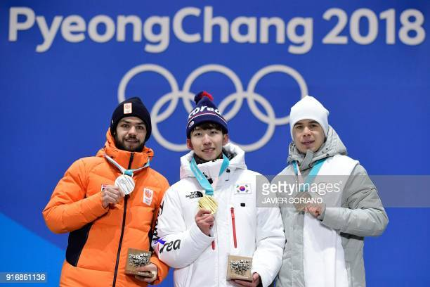 Netherlands' silver medallist Sjinkie Knegt South Korea's gold medallist Lim Hyojun and Russia's bronze medallist Semen Elistratov pose on the podium...