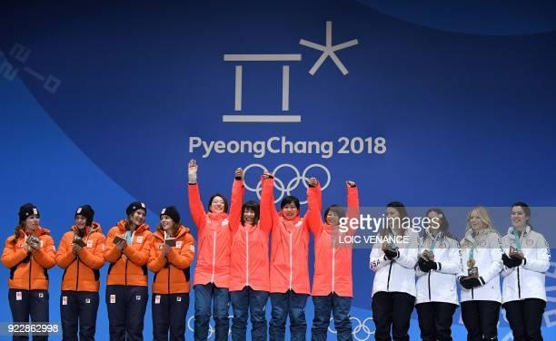 Netherlands' silver medallists Antoinette de Jong Marrit Leenstra Lotte van Beek and Ireen Wust Japan's gold medallists Miho Takagi Ayaka Kikuchi...