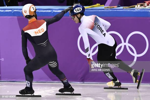 Netherlands' Sjinkie Knegt congratulates South Korea's Lim Hyojun after Lim won the men's 1,500m short track speed skating A final event during the...