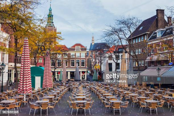 netherlands, south holland, hague, cafe on courtyard - the hague stock photos and pictures