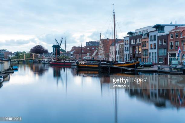 netherlands, south holland, leiden, sailboat moored in old harbor by galgewater - ライデン ストックフォトと画像