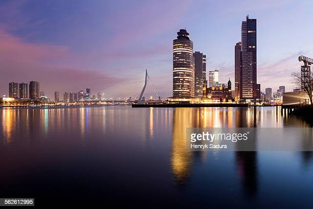 Netherlands, South Holland, Rotterdam, Illuminated skyscrapers reflecting in water