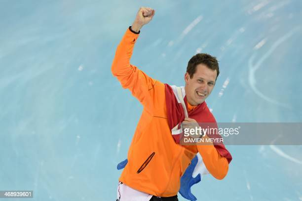 Netherlands' Stefan Groothuis celebrates after winning the gold medal in the Men's Speed Skating 1000 m at the Adler Arena during the Sochi Winter...