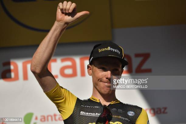 Netherlands' Steven Kruijswijk celebrates on the podium after he received a prize for being the day's most aggressive rider following the twelfth...