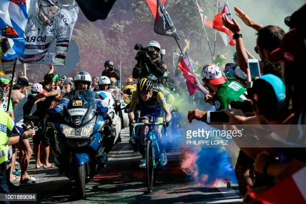 TOPSHOT Netherlands' Steven Kruijswijk rides through flare bomb smoke in the ascent to l'Alpe d'Huez during the twelfth stage of the 105th edition of...