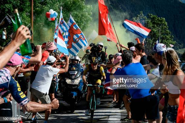 Netherlands' Steven Kruijswijk rides through spectators in the ascent to l'Alpe d'Huez during the twelfth stage of the 105th edition of the Tour de...