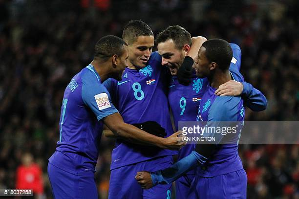 Netherlands' striker Vincent Janssen celebrates scoring an equalising goal for 11 during the international friendly football match between England...