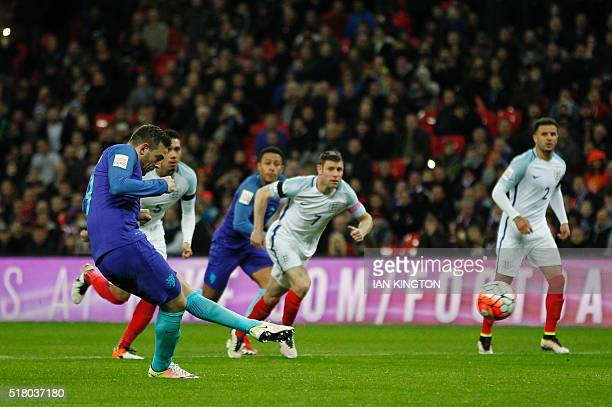 Netherlands' striker Vincent Janssen scores an equalising goal for 11 from the penalty spot during the international friendly football match between...