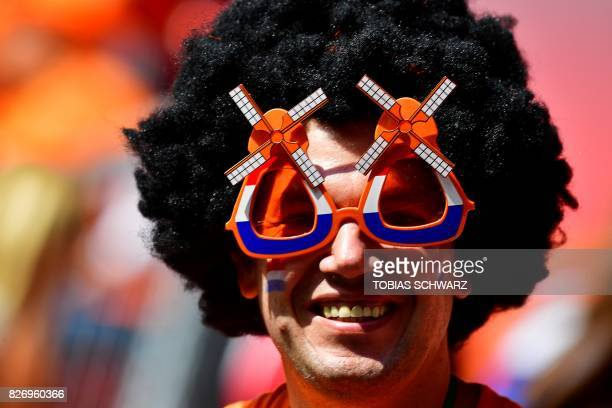 Netherlands' supporter poses with glasses shaped as windmills prior to the UEFA Womens Euro 2017 football tournament final match between Netherlands...