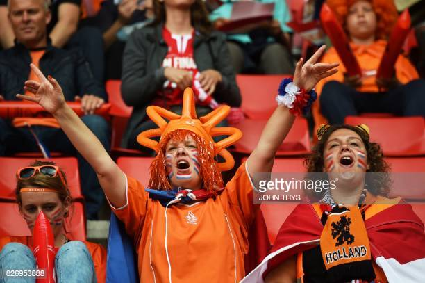 Netherlands' supporters chant slogans as they cheer for their team prior to the UEFA Womens Euro 2017 football tournament final match between...