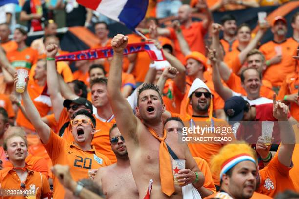 Netherlands' supporters cheer for their team before the UEFA EURO 2020 round of 16 football match between the Netherlands and the Czech Republic at...