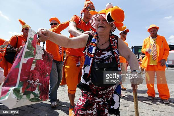 Netherlands supporters enjoy the atmosphere before the UEFA EURO 2012 match between Holland and Denmark at the Metalist Stadium on June 9 2012 in...